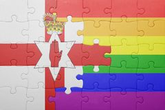 Puzzle with the national flag of northern ireland and gay flag Royalty Free Stock Photography