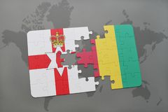 Puzzle with the national flag of northern ireland and guinea on a world map. Background. 3D illustration Royalty Free Stock Image