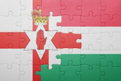 Puzzle with the national flag of northern ireland and hungary Stock Photography