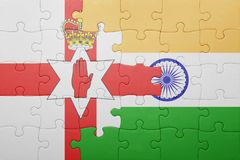 Puzzle with the national flag of northern ireland and india Royalty Free Stock Photography