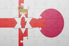 Puzzle with the national flag of northern ireland and japan Royalty Free Stock Image