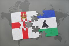 Puzzle with the national flag of northern ireland and lesotho on a world map Royalty Free Stock Photo