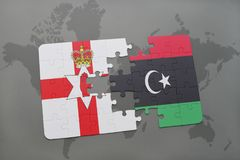 Puzzle with the national flag of northern ireland and libya on a world map. Background. 3D illustration Royalty Free Stock Image