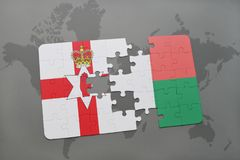 Puzzle with the national flag of northern ireland and madagascar on a world map. Background. 3D illustration Royalty Free Stock Images