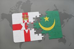 Puzzle with the national flag of northern ireland and mauritania on a world map. Background. 3D illustration Royalty Free Stock Photography