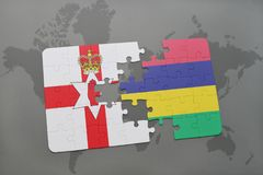 Puzzle with the national flag of northern ireland and mauritius on a world map. Background. 3D illustration Royalty Free Stock Image