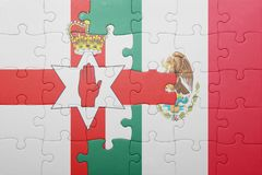 Puzzle with the national flag of northern ireland and mexico. Concept stock photo
