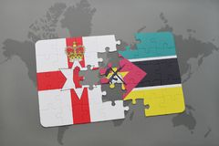 Puzzle with the national flag of northern ireland and mozambique on a world map. Background. 3D illustration Royalty Free Stock Image