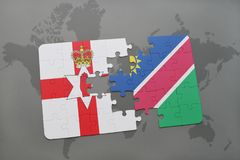 Puzzle with the national flag of northern ireland and namibia on a world map. Background. 3D illustration Royalty Free Stock Photography