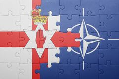 Puzzle with the national flag of northern ireland and nato Stock Images