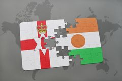 Puzzle with the national flag of northern ireland and niger on a world map. Background. 3D illustration Royalty Free Stock Photos