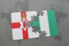 Puzzle with the national flag of northern ireland and nigeria on a world map. Background. 3D illustration Royalty Free Stock Photography