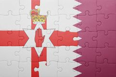 Puzzle with the national flag of northern ireland and qatar Royalty Free Stock Image