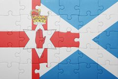 Puzzle with the national flag of northern ireland and scotland Stock Photo
