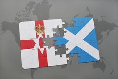 Puzzle with the national flag of northern ireland and scotland on a world map background. Royalty Free Stock Photos