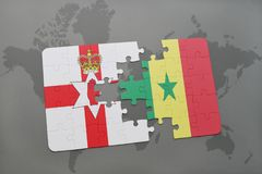 Puzzle with the national flag of northern ireland and senegal on a world map. Background. 3D illustration Royalty Free Stock Image