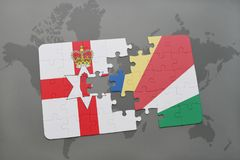 Puzzle with the national flag of northern ireland and seychelles on a world map Stock Photography