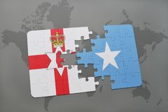 Puzzle with the national flag of northern ireland and somalia on a world map Stock Photo