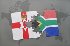 Puzzle with the national flag of northern ireland and south africa on a world map Royalty Free Stock Images