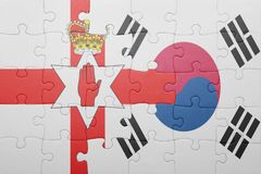 Puzzle with the national flag of northern ireland and south korea Royalty Free Stock Photography