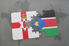 Puzzle with the national flag of northern ireland and south sudan on a world map Royalty Free Stock Photos