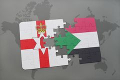 Puzzle with the national flag of northern ireland and sudan on a world map Stock Photo