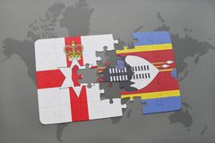 Puzzle with the national flag of northern ireland and swaziland on a world map Stock Photos
