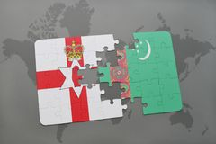 Puzzle with the national flag of northern ireland and turkmenistan on a world map Stock Photography