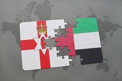 Puzzle with the national flag of northern ireland and united arab emirates on a world map Stock Photography