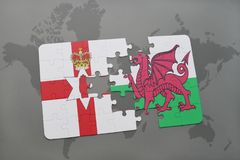 Puzzle with the national flag of northern ireland and wales on a world map background. Stock Image