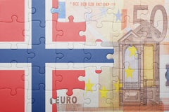 Puzzle with the national flag of norway and euro banknote Stock Photography