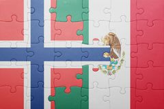 Puzzle with the national flag of norway and mexico. Concept royalty free stock image