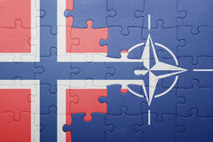 Puzzle with the national flag of norway and nato Royalty Free Stock Photography