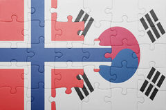 Puzzle with the national flag of norway and south korea. Concept royalty free stock images