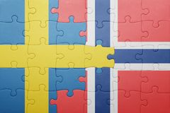 Puzzle with the national flag of norway and sweden Royalty Free Stock Image