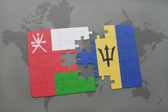 puzzle with the national flag of oman and barbados on a world map background. Royalty Free Stock Photography