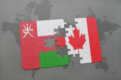 Puzzle with the national flag of oman and canada on a world map background. Royalty Free Stock Photo