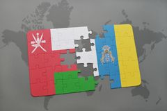 Puzzle with the national flag of oman and canary islands on a world map background. 3D illustration royalty free stock photo