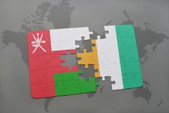 Puzzle with the national flag of oman and cote divoire on a world map background. 3D illustration Royalty Free Stock Images
