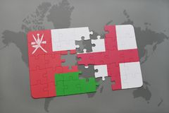 Puzzle with the national flag of oman and england on a world map background. Stock Photo