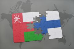 Puzzle with the national flag of oman and finland on a world map background. Royalty Free Stock Photos