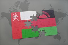 Puzzle with the national flag of oman and malawi on a world map background. 3D illustration Stock Photography