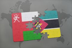 Puzzle with the national flag of oman and mozambique on a world map background. Stock Photo