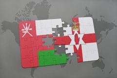 Puzzle with the national flag of oman and northern ireland on a world map background. 3D illustration Royalty Free Stock Images