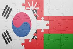 Puzzle with the national flag of oman and south korea. Concept royalty free stock photography