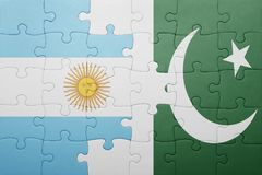 Puzzle with the national flag of pakistan and argentina Royalty Free Stock Photography