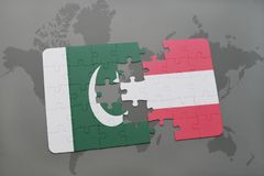 Puzzle with the national flag of pakistan and austria on a world map background. 3D illustration Royalty Free Stock Images