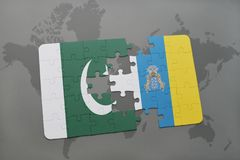 Puzzle with the national flag of pakistan and canary islands on a world map background. 3D illustration Royalty Free Stock Photography