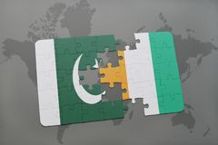 Puzzle with the national flag of pakistan and cote divoire on a world map background. 3D illustration Stock Photography
