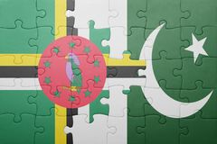 Puzzle with the national flag of pakistan and dominica. Concept stock photography